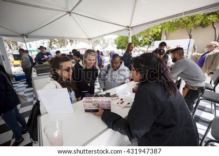 SAN MATEO, CA May 20 2016 - Three women receive instructions for an activity at the 11th Annual Bay Area Maker Faire at the San Mateo County Event Center.