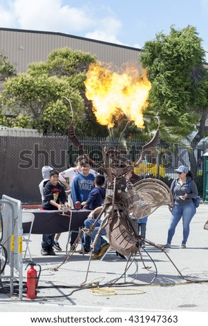 SAN MATEO, CA May 20 2016 - Two boys operate a flaming interactive art sculpture during the 11th Annual Bay Area Maker Faire at the San Mateo County Event Center.
