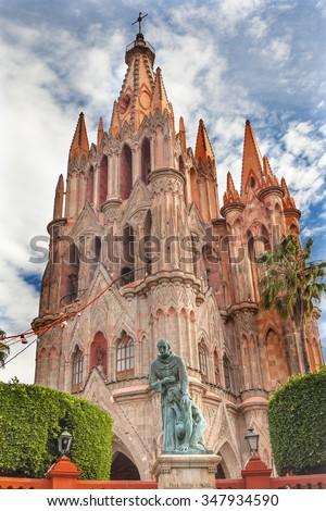 SAN MIGUEL DE ALLENDE, MEXICO - DECEMBER 27, 2014 Father Juan de San Miguel Statue Parroquia Church San Miguel de Allende, Mexico. Parroquia created in 1600s and facade created in 1880s.   - stock photo