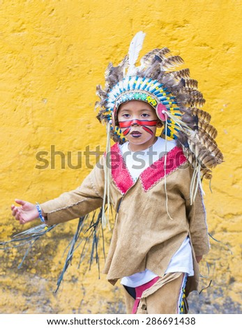 SAN MIGUEL DE ALLENDE , MEXICO - MAY 31 : Native American boy with traditional costume participates at the festival of Valle del Maiz on May 31 , 2015 in San Miguel de Allende ,Mexico.