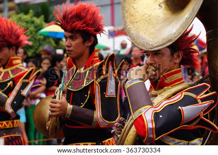 SAN PABLO CITY, LAGUNA, PHILIPPINES - JANUARY 15, 2016: Band musicians play French Horn during the annual brass band exhibition in honor of Patron Saint Paul the First Hermit Feast. Public Event - stock photo