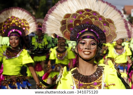 "SAN PABLO CITY, LAGUNA PHILIPPINES - JANUARY 2012: Female street dancer smiles as she dances along Rizal Avenue during the 17th Annual  Coconut Festival Celebration. ""Editorial"" - stock photo"
