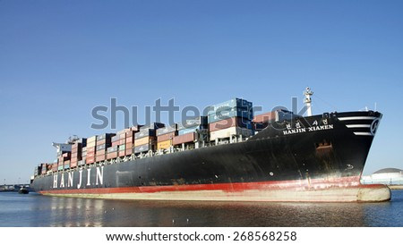 SAN PEDRO, CA - APRIL 09, 2015: Hanjin Cargo Ship HANJIN XIAMEN departing the Port of Los Angeles. The Port of LA is the busiest container port in the United States.