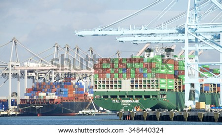 SAN PEDRO, CA - NOVEMBER 24, 2015: APL PHILIPPINES and ITAL USODIMARE loading at the Port of Los Angeles. The Port of Los Angeles  occupies 7,500 acres of land and water along 43 miles of waterfront - stock photo