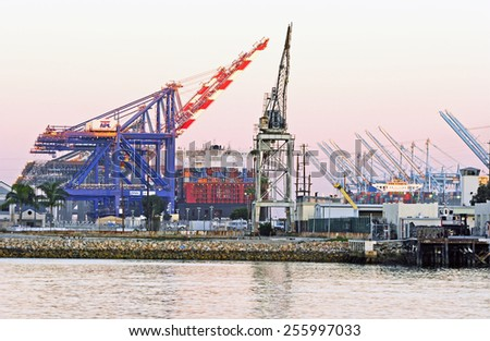 SAN PEDRO/CALIFORNIA - FEBRUARY 8, 2015: Los Angeles Harbor shipyard cranes and containers. A leading seaport in North America. February 8, 2015 San Pedro, California USA