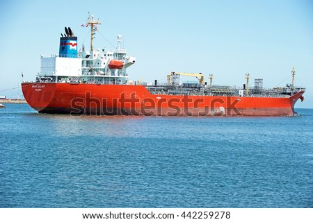 SAN PEDRO/CALIFORNIA - JUNE 22, 2016: Amagi Galaxy an oil / chemical tanker ship being escorted out of the channel by Crowley tugboats at the Los Angeles Harbor, in Los Angeles, California USA