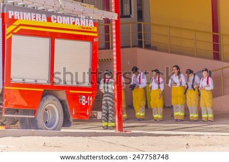 SAN PEDRO DE ATACAMA, CHILE, MAY 18, 2014: Fire brigade (mostly female) during a meeting in front of fire station  - stock photo