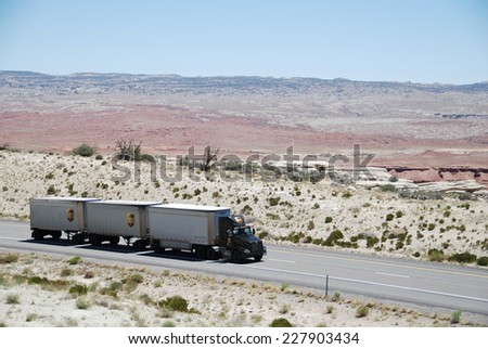 SAN RAFAEL VALLEY, UT, USA - JUNE 6, 2008: a truck drives through San Rafael desert on Route 70. Trucks carry nearly 70 percent of all freight transported annually in the U.S. - stock photo