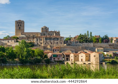 San Salvador Cathedral of Zamora and acenas (water mills), view from Duero river. Castilla y Leon, Spain. - stock photo