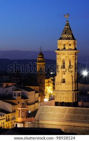 San Sebastian (nearest) & San Augustin towers at dusk, Antequera, Malaga Province, Andalusia, Spain, Western Europe. - stock photo