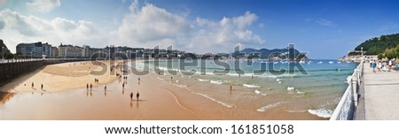 SAN SEBASTIAN, SPAIN - SEP 10: Beach of La Concha on September 10, 2012 in San Sebastian, Spain. With length of 1350 meters and 40 meters wide, it is one of the most famous urban beaches in Spain.