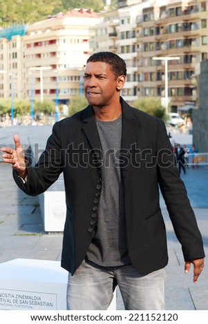 SAN SEBASTIAN - SPAIN - SEPTEMBER 24: Denzel Washington poses for photographers before the press conference of The Equalizer film in the film festival of San Sebatian 2014 on September 2014 - stock photo