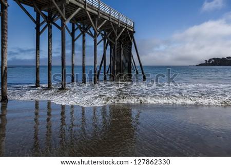 San Simoen Pier reflects in water below - stock photo