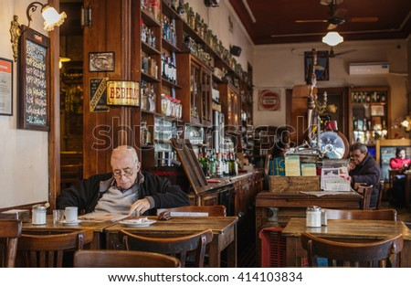 "SAN TELMO, BUENOS AIRES, ARGENTINA - APRIL 28: old man reading a morning newspaper in one of the oldest cafes in Buenos Aires, Argentina on April 28, 2016. Bar ""El Federal"" was established in 1864."