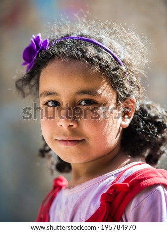 SANA'A, YEMEN - JAN 11, 2014: Unidentified Yemeni girl in the street in Sana'a. Children of Yemen grow up without education