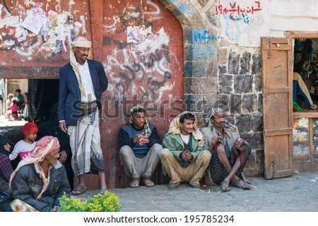 SANA'A, YEMEN - JAN 11, 2014: Unidentified Yemeni local people at the market. People of Yemen suffer of poverty due to the unstable political and poor economical situation