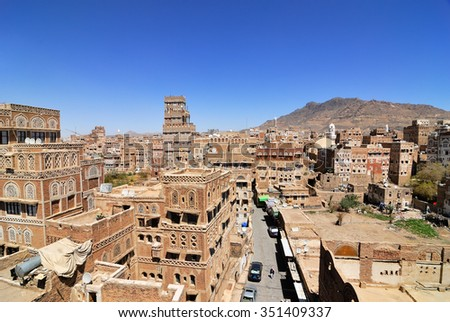 SANAA, YEMEN - MAR 6, 2010: View from roof  on the street in the old centre of Sanaa. Inhabited for more than 2.500 years, Sanaa is the UNESCO World Heritage City now destroyed by the civil war