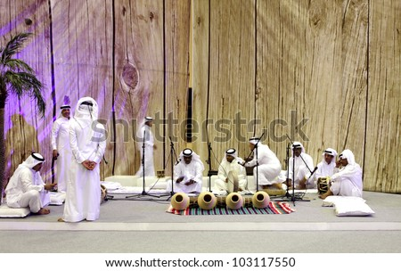 SANABIS, BAHRAIN - MAY 04: People performs folklore pearling songs with traditional musical instruments during 20th Heritage festival  2012 in Sanabis, Bahrain on May 04, 2012 - stock photo