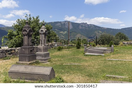 SANAHIN, ARMENIA - JULY 19, 2015: Graves in the park of Sanahin Monastery founded in the 10th century in the Lori Province of Armenia.