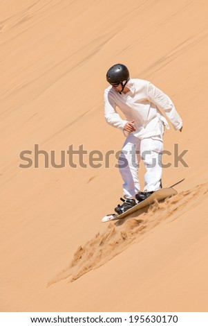 Sanboarder in action in Namibia - stock photo