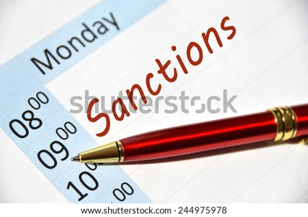 Sanctions writing on the agenda  - stock photo