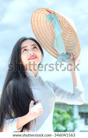 Sanctity beauty of women in Vietnam with beautiful face, big round eyes, long hair and conical hats posing pretty slim very beautiful to behold