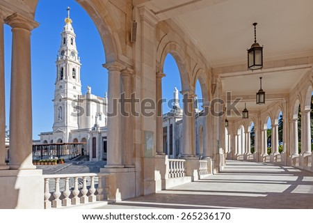 Sanctuary of Fatima, Portugal. Basilica of Our Lady of the Rosary seen from and through the colonnade. One of the most important Marian Shrines and pilgrimage locations for Catholics - stock photo