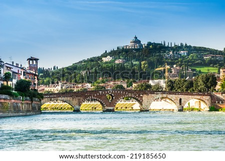 Sanctuary of the Madonna of Lourde, Verona, Italy, over the river with an ancient bridge . - stock photo