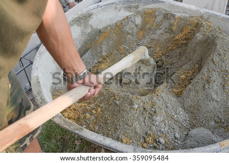 Sand and cement were mixed by hoe