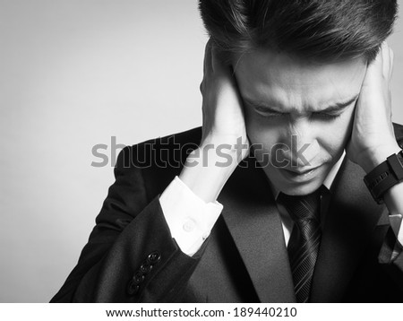 Sand and depressed business man. - stock photo