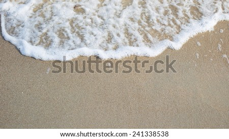 Sand and fresh sea wave background. - stock photo