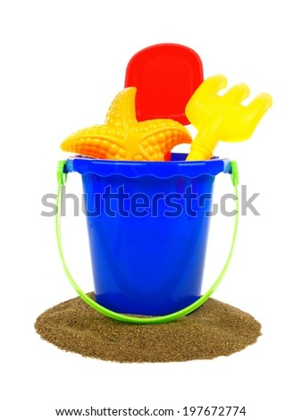 Sand and pail with beach toys over a white background - stock photo