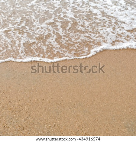 Sand and sea on the beach. Abstract natural for travel and summer background. - stock photo
