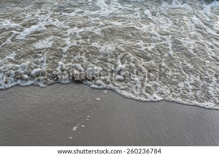 Sand and Surf black beach . - stock photo