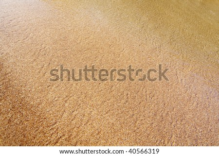 Sand background with a shadow for highlighting the central part