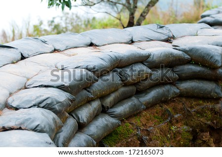 Sand bag bunker with green background