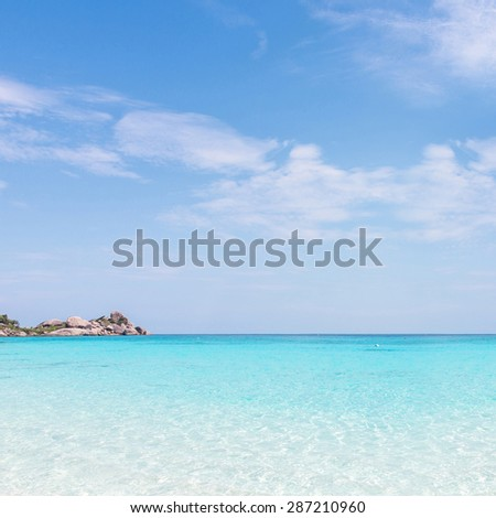 sand beach against blue sky. Similan islands, Thailand, Phuket. :The turquoise blue color of the Similan Islands in Thailand concept of tourism, leisure and honeymoon. During the summer - stock photo