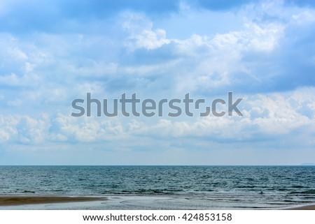 Sand beach and blue sky and sea - stock photo