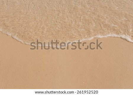 Sand beach and sea wave - stock photo