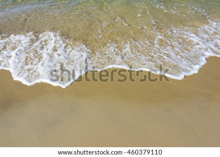 sand beach and sea wave background,select focus with shallow depth of field:ideal use for background - stock photo