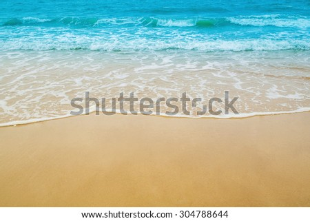 sand beach and sea wave for natural background - stock photo
