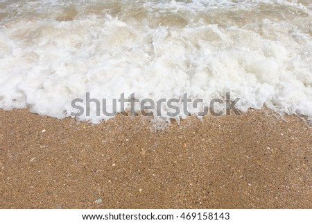 Sand beach and wave