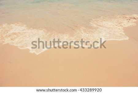 Sand beach and wave background made with vintage filter. - stock photo