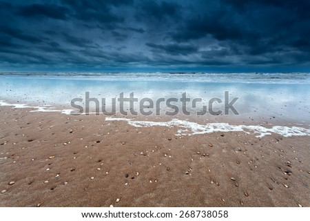 sand beach at storm on North sea, Holland - stock photo