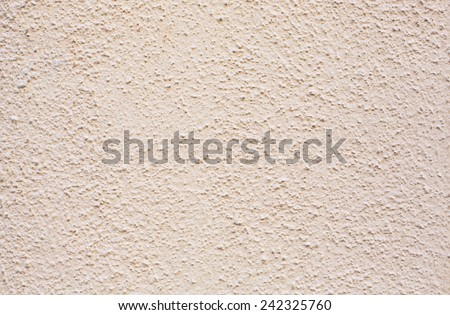 Sand/beige wall texture background - stock photo
