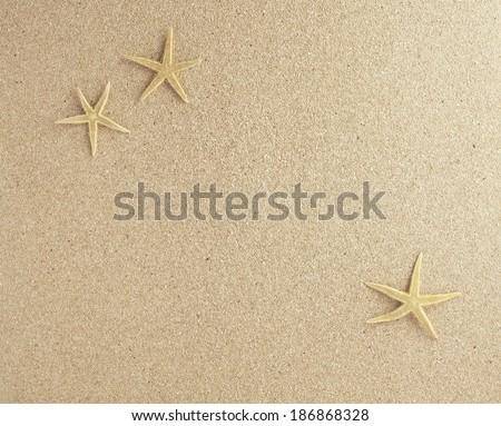 sand bottom with three starfish plan view - stock photo