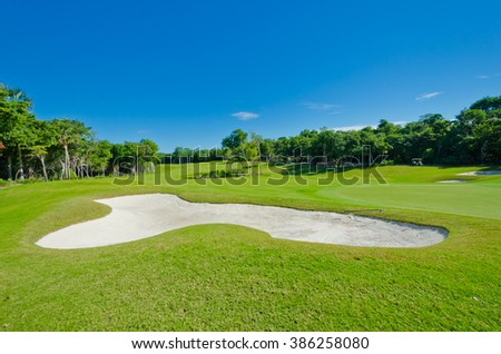 Sand bunker at the beautiful caribbean, tropical golf course. - stock photo