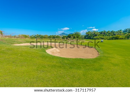 Sand bunker, at the beautiful golf course.