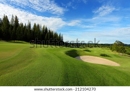 Sand bunker on golf course - stock photo