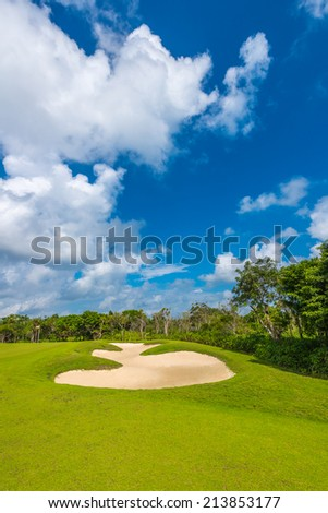 Sand bunker on the beautiful golf course. Luxury Mexican resort. Vertical.